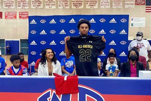 West Brook senior Bryce Anderson holds up his Under Armour All-American jersey during a ceremony on Friday morning.