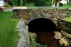 Rowayton Ave is closed at Keelers Brook watercourse bridge Tuesday, July 20, 2021, in Norwalk, Conn.