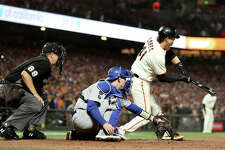 SAN FRANCISCO, CALIFORNIA - OCTOBER 14: Wilmer Flores #41 of the San Francisco Giants strikes out on a checked swing for the final out of the game against the Los Angeles Dodgers during the ninth inning in game 5 of the National League Division Series at Oracle Park on October 14, 2021 in San Francisco, California. The Los Angeles Dodgers beat the San Francisco Giants 2-1. (Photo by Harry How/Getty Images)