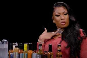 """Megan Thee Stallion suffered through """"Hot Ones"""" like a champ."""
