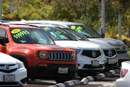 Used cars are displayed on the sales lot of a dealer in Corte Madera, Calif.