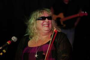 """Musicians are gathering for a """"Jam For Erica,"""" benefit concert for Newtown blues violinist Erica Schwichtenberg at the NewSylum Brewery Company business in Newtown from 1 to 5 p.m., on Sunday. She is also a rock violinist, and a singer. She is previously shown at a concert wearing sunglasses."""