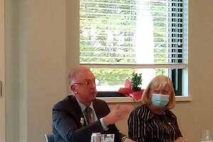 Community Health & Wellness Center of Greater Torrington's CEO, Joanne Borduas, held a round table discussion Friday on the challenges of providing health care and mental health services to rural communities. Sharon Hospital president Mark Hirko speaks during the discussion. He is seated with