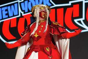 Irish Harvey walks the stage at the New York Comic Con Costume Central Championship of Cosplay, where she won third place for her portrayal of Edelgard from the video game Fire Emblem: Three Houses on Saturday, Oct. 9, 2021.