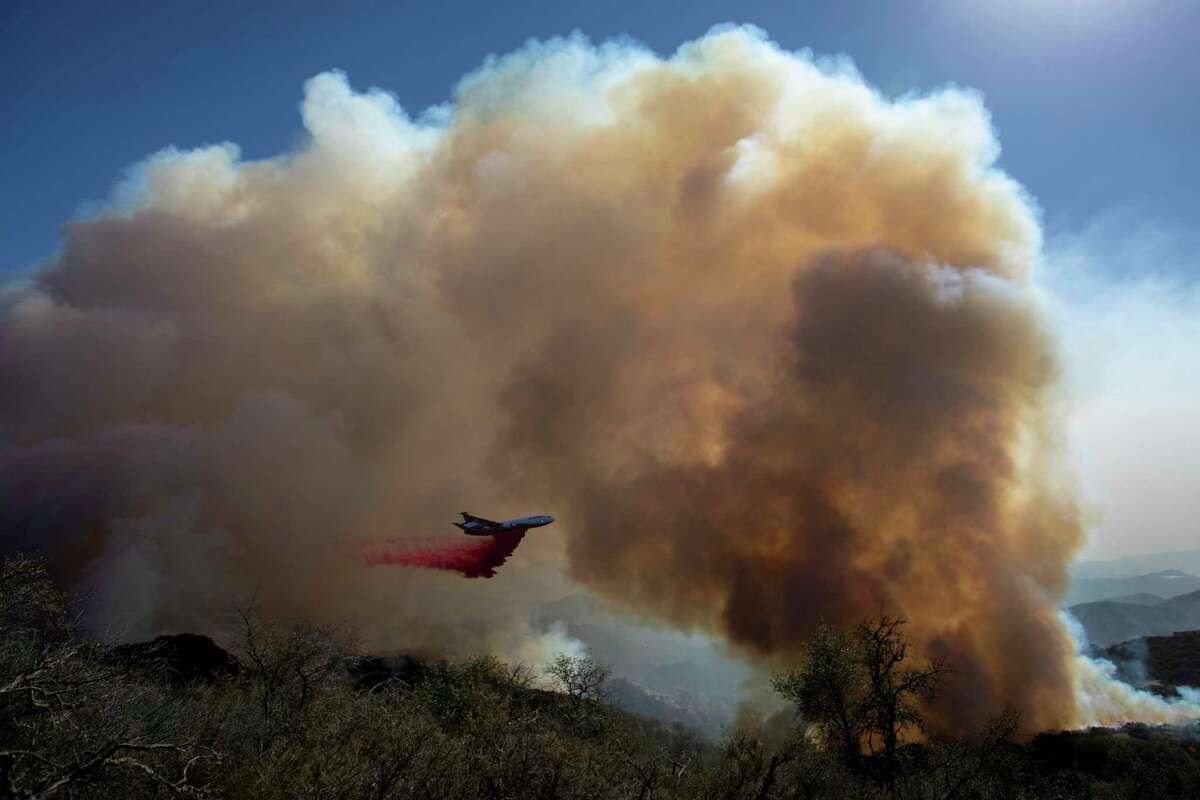 A firefighting jet drops retardant on the Alisal Fire near Goleta (Santa Barbara County) on Wednesday.