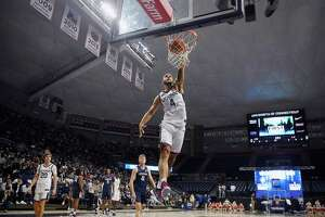 UConn's Tyrese Martin dunks during First Night events for the men's and women's basketball teams on Friday in Storrs.