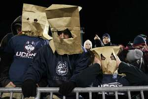 UConn fans wear bags on their heads during a 2013 game against Louisville in East Hartford.
