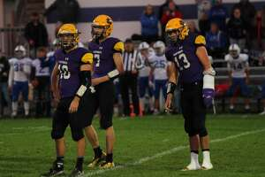 The Frankfort Panthers look towards the sidelines before running a play against Hopkins.