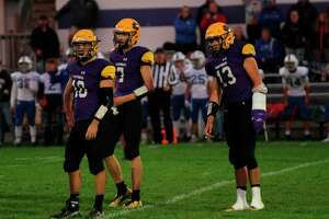 The Frankfort Panthers look towards the sidelines before running a play against Hopkins. (McLain Moberg/Record Patriot)