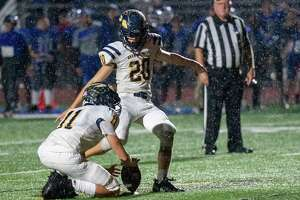 With Jack Adams holding, Averill Park kicker Luke Hempel hits the game winning extra point in overtime to beat LaSalle Institute during a Class A matchup at LaSalle Institute in Troy, NY, on Friday, Oct. 15, 2021. (Jim Franco/Special to the Times Union)
