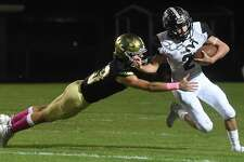 Little Cypress-Mauriceville's Nicholas Granger dives to stop Vidor's #2 during their match-up at LCM Friday. Photo made Friday, October 15, 2021 Kim Brent/The Enterprise