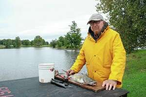 """Charles """"Catfish Charlie"""" Jobe, 92, doesn't drive anymore, but that doesn't stop him from fishing. With the help of family and friends, Jobe converted a riding mower with a trailer so he can get to Nichols Park to fish."""