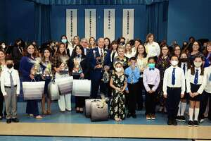Former UISD Superintendent Robert J. Santos gathers with family, students, faculty and staff of Robert J. Santos Elementary Friday, Oct. 15, 2021, during a dedication ceremony for the school.
