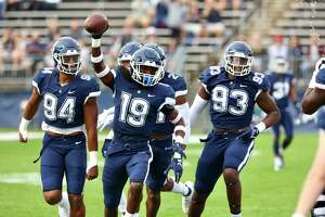 UConn's Durante Jones (19) celebrates with teammates after a play against Yale on Saturday.