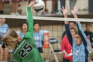 Monahans' Valerie Hunt goes up for the kill as Greenwood''s Kylee Whisman tries to block 10/16/2021 at Greenwood High School. Tim Fischer/Reporter-Telegram
