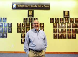 Tom Chiappetta, executive director of the Fairfield County Sports Commission, poses for a photo in front of the Fairfield County Sports Hall of Fame inside UConn Stamford in Stamford, Conn. on Tuesday, March 28, 2017.