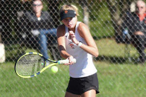 Edwardsville's Alyssa Wise returns a shot during her doubles match at the Edwardsville Sectional on Saturday inside the EHS Tennis Center.