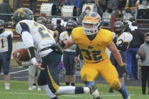 Cole Hopkins (32) and the Evart football team had another big day on Friday. (Pioneer file photo)