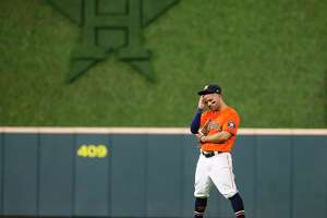 Houston Astros second baseman Jose Altuve (27) stands in the field during the eighth inning in Game 2 of the American League Championship Series on Saturday, Oct. 16, 2021, at Minute Maid Park in Houston.