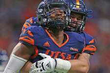 UTSA Dadrian Taylor (7) celebrates with a teammate after he and other defenders stopped the Rice defender on the 1 yard line on Saturday, Oct. 16, 2021 at the Alamodome.