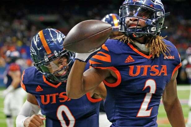 UTSA quarterback Frank Harris congratulates wide receiver Joshua Cephus (2) after his touchdown reception. UTSA defeated Rice 45-0 on Saturday, Oct. 16, 2021 at the Alamodome.