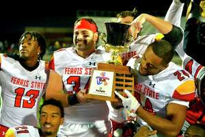 Ferris players celebrate keeping the Anchor-Bone Trophyagainst Grand Valley on Saturday. (Photo courtesy of Ferris Athletics)