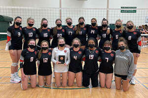 The Edwardsville volleyball team poses with the third-place plaque from the Plainfield Central Tournament on Saturday.