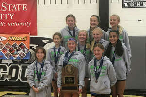 Members of the Liberty Middle School girls cross country team pose with the third-place trophy from the IESA Class 3A state meet on Saturday in Normal.
