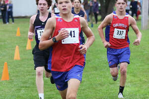 Carlinville's Will Meyer (front) runs during a race last season at Loveless Park in Carlinville. On Saturday in Piasa, Meyer finished second to lead the Cavaliers to a conference championship in the SCC Meet.