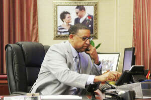 Alton Mayor David Goins pauses during a Friday interview to take a call in his office. Elected the city's first Black mayor in April, he said there have been challenges but they are being dealt with head on.