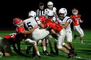 Ike Koscielski (4) and Nate Childers (2) come up to stop the Sault Ste. Marie ball carrier in his tracks during Friday's loss. (Robert Myers/Record Patriot)