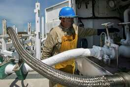 FILE - In this Tuesday, April 2, 2019, file photo, Miguel Cortillo gets a tanker of liquefied natural gas ready at Stabilis Energy in George West, Texas, to transport it to Laredo. An Energy Department official's colorful description of liquefied natural gas is lighting a fire under environmentalists. (Marie D. De Jesus/Houston Chronicle via AP, File)