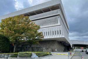A panel on what appears to be the roof overhang fell off the New York State Museum Sunday, Oct. 18, 2021. The debris hit a terrace level of the building. No one was hurt.