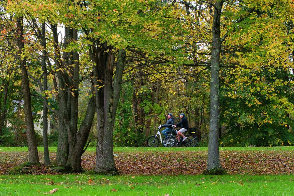 People ride along the bike path on Sunday, Oct. 17, 2021, in Round Lake, N.Y.