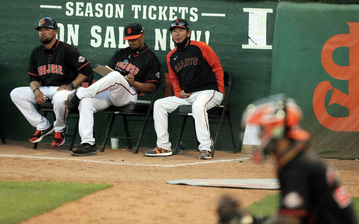 San Jose Giants manager Lenn Sakata with his coaching staff during the San Jose Giants game against the Modesto Nuts at Excite Ballpark in San Jose, Calif., on Thursday, June 3, 2021.