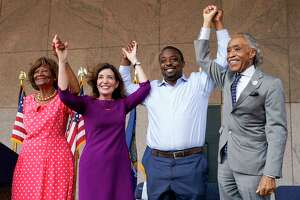 Dr. Hazel N. Dukes, President of the NAACP New York State Conference, left, New York Gov. Kathy Hochul, second from left, state Sen. Brian Benjamin, and the Rev. Al Sharpton stand together during an event in the Harlem neighborhood of New York, Thursday, Aug. 26, 2021, in New York. Hochul has selected Benjamin as her choice for lieutenant governor. (AP Photo/Mary Altaffer)