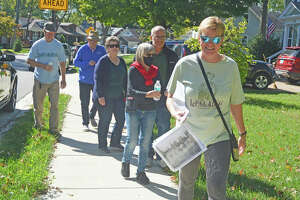 Laurie Frey, right, a longtime Leclair resident, leads a walking tour Sunday during the 29th annual Leclaire Parkfest.