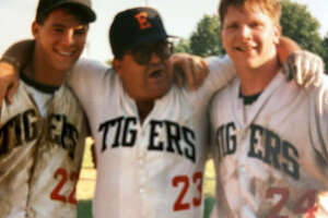 Edwardsville's J.J. Scerba, right, celebrates with EHS coach Tom Pile, middle, and teammate Dave Slemmer after the Tigers won the Class AA state championship in 1990.