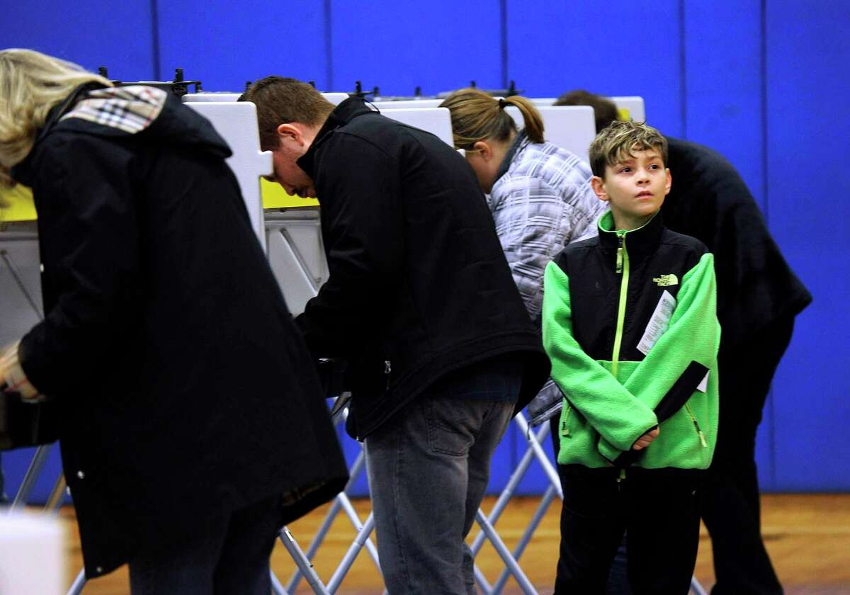 Voters at the Brookfield High School polling place Election Day, Tuesday, Nov. 7, 2017.