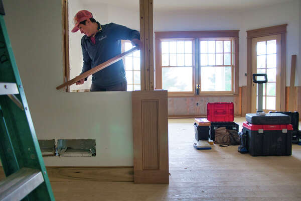 Susy Easterly, a lead carpenter at Teakwood Builders, works inside a home on Tuesday, Sept. 28, 2021, in Greenfield, N.Y.