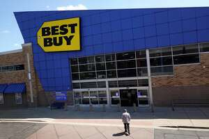 CHICAGO, ILLINOIS - AUGUST 24: Customers shop at a  Best Buy  store on August 24, 2021 in Chicago, Illinois.