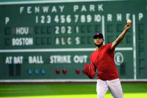 Boston Red Sox Game 3 starting pitcher Eduardo Rodríguez throws at a baseball practice at Fenway Park, Sunday, Oct. 17, 2021, in Boston. The Red Sox host the Houston Astros on Monday night. (AP Photo/Robert F. Bukaty)