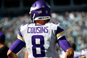 """CHARLOTTE, NORTH CAROLINA - OCTOBER 17: The helmet of Kirk Cousins #8 of the Minnesota Vikings reads """"End Racism"""" during the game against the Carolina Panthers at Bank of America Stadium on October 17, 2021 in Charlotte, North Carolina. (Photo by Mike Comer/Getty Images)"""