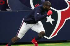 Houston Texans defensive end Whitney Mercilus warms up before an NFL pre-season football game Saturday, Aug. 28, 2021, in Houston.