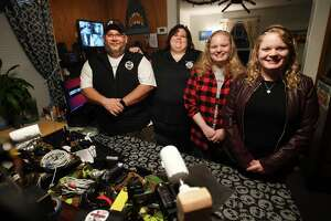 Liberty Ghost Hunters is a family affair in West Haven, Conn. on Monday, Oct. 11, 2021. From left are John and Diana McManus, and nieces Brittany and Stephanie Eburg.