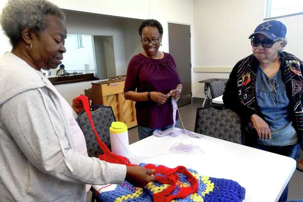 Ruby Chargois shows a work in progress to Caron Tigner (center) and Mary Ellison during crochet class at the Lakeside Center Best Years. The senior center offers a myriad of programs and activities as well as meals Monday through Friday to provide a holistic balance of activities for those 55 and older. Photo made Monday, October 18, 2021 Kim Brent/The Enterprise