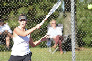 Edwardsville's Hannah Colbert follows through on a forehand shot during her doubles championship match at the Class 2A Edwardsville Sectional.