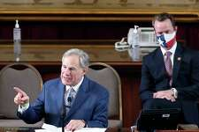 Gov. Greg Abbott delivers a speech while newly elected Speaker of the House, Dade Phelan joins him during the convening of the 87th Texas Legislature in Austin on Tuesday, Jan. 12, 2021.