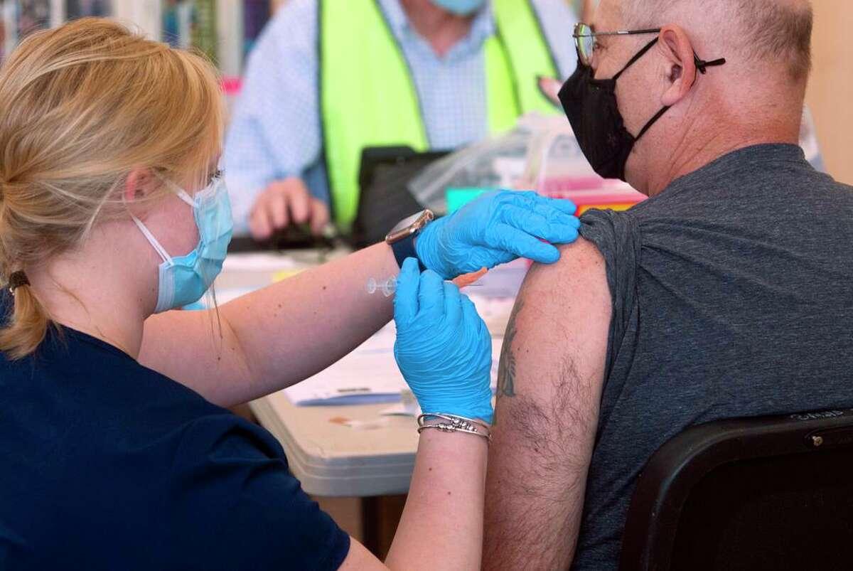 Mallory Bates, a nurse at Norwalk Hospital, administers a COVID-19 vaccine to Salvatore Rigillo on March 20.