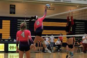Lola Piper takes a big swing at the net during Manistee's win on Oct. 18. (Robert Myers/News Advocate)
